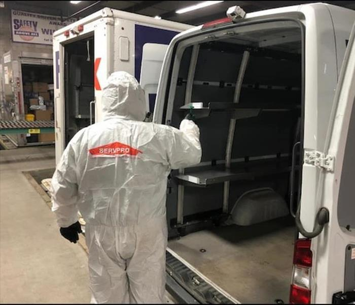 SERVPRO employee suited up ready to clean a FedEx truck
