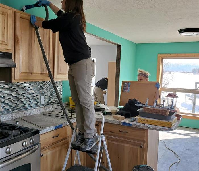 Our marketing team Megan and Melissa cleaning a kitchen in a home